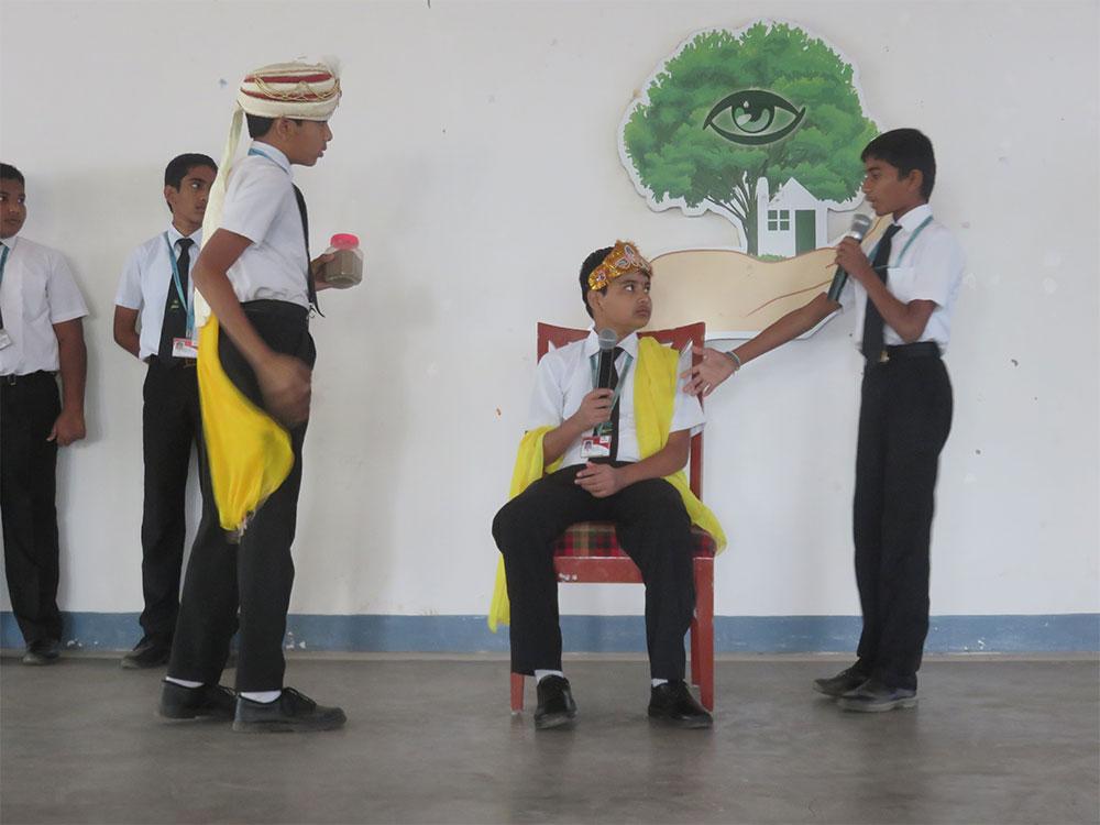 Students perform a short telugu moral skit showing